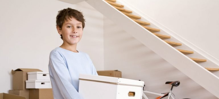 Boy unpacking in new home