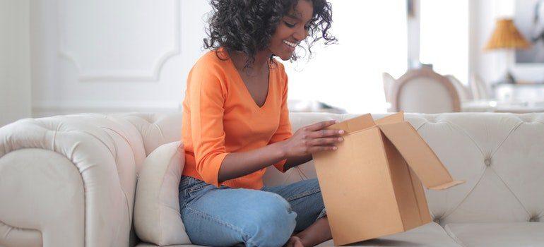 Woman unpacking.