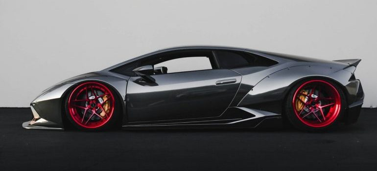 Black Lamborghini with red rims - Moving your car across the country
