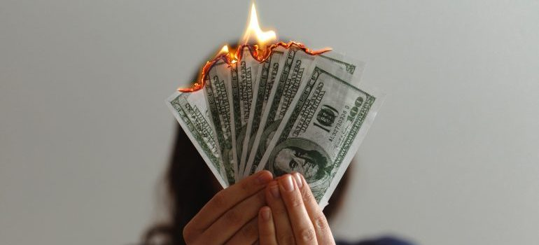 money burning away because of hidden moving fees