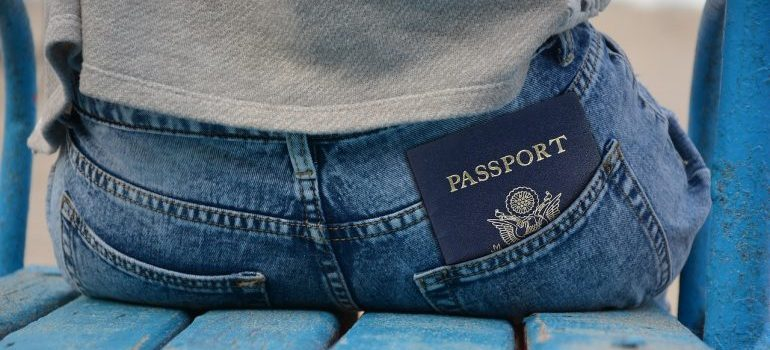 A passport in a man's back pocket