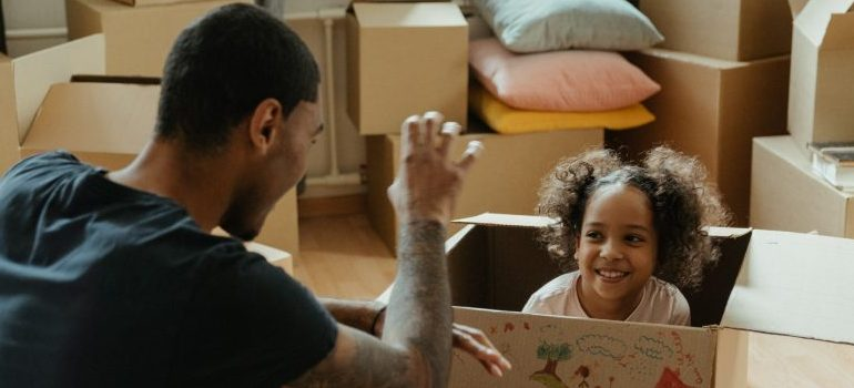 A father and daughter preparing for the move.