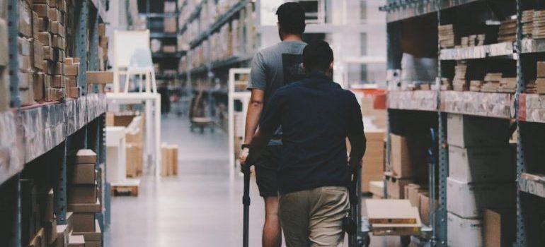 men-going-around-a-warehouse