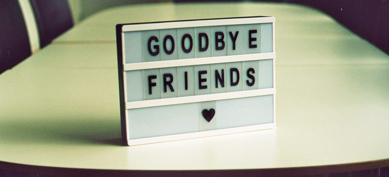 "table decoration with letters spelling ""goodbye friends"""