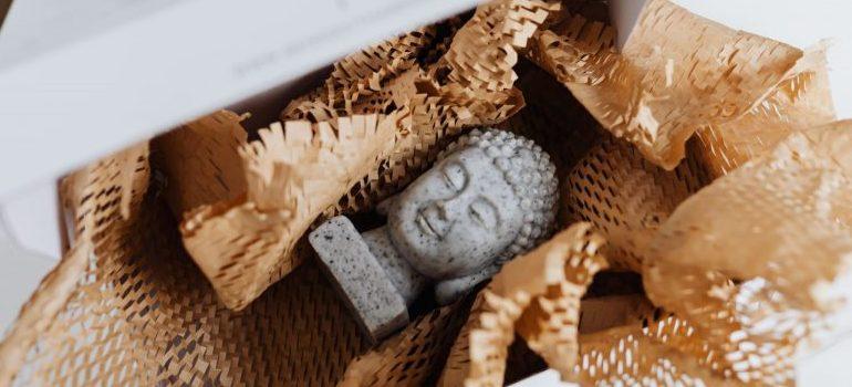 statue of Buddha in a cardboard box