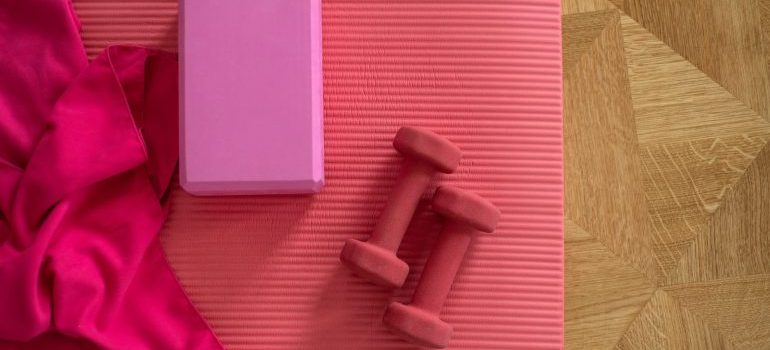 weights on a yoga mat