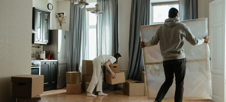 man and woman packing and moving stuff