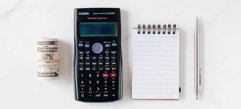 money, calculator, pen and paper