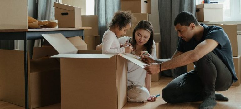 parents helping daughter to unpack after the move
