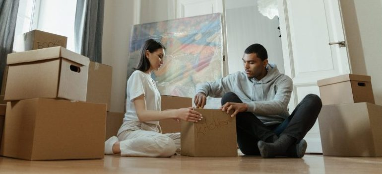 couple packing a kitchen cardboard box