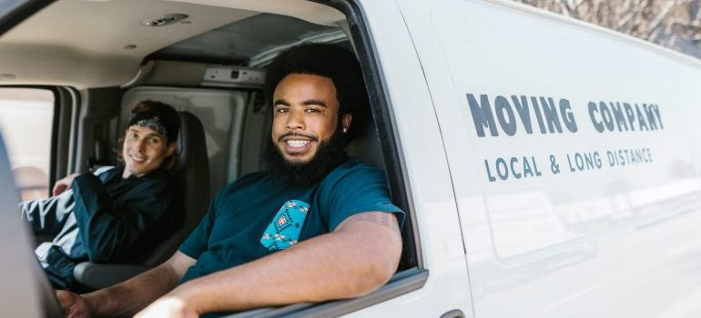 two movers inside a moving van