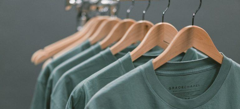 green shirts on hangers