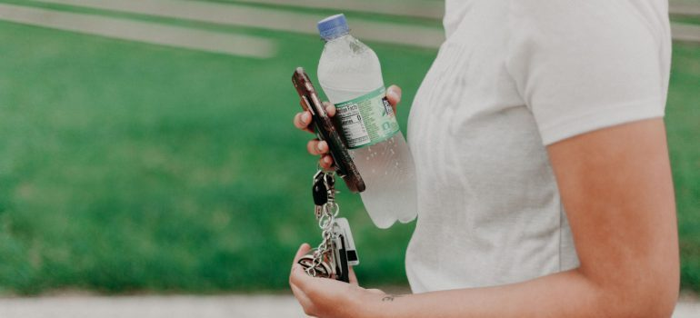 a woman holding a water bottle
