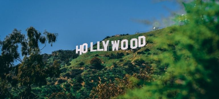 a sign of hollywood welcomes people moving from Brooklyn.