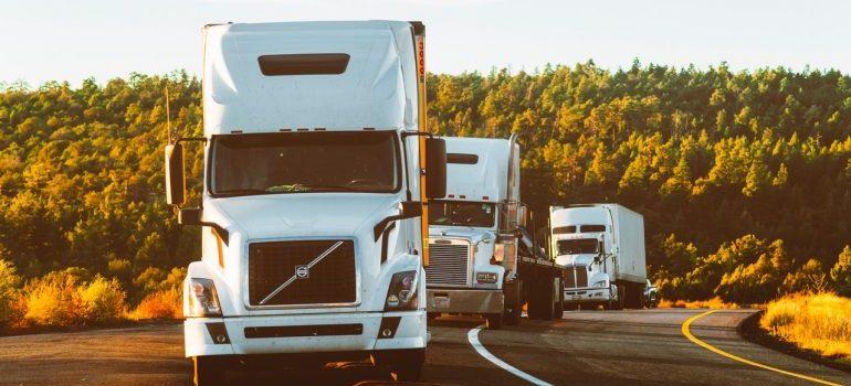 three trucks on the road