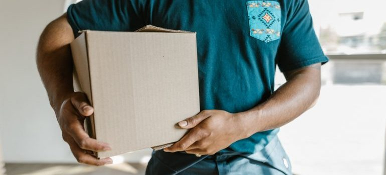 A mover holding a moving box