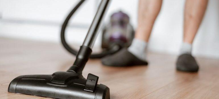 a man vacuuming the floor