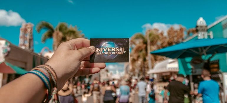A girl's hand holding a printed out ticked for Universal Studios