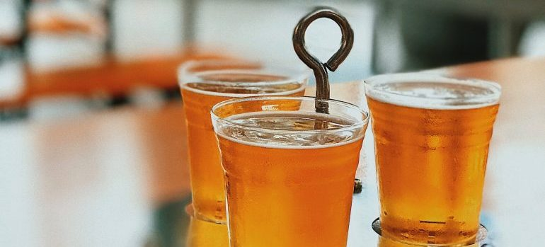 three glasses of beer on the table