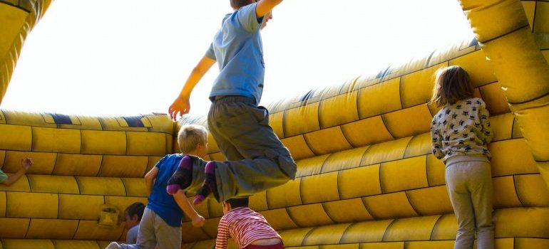 Kids playing in a bouncy castle