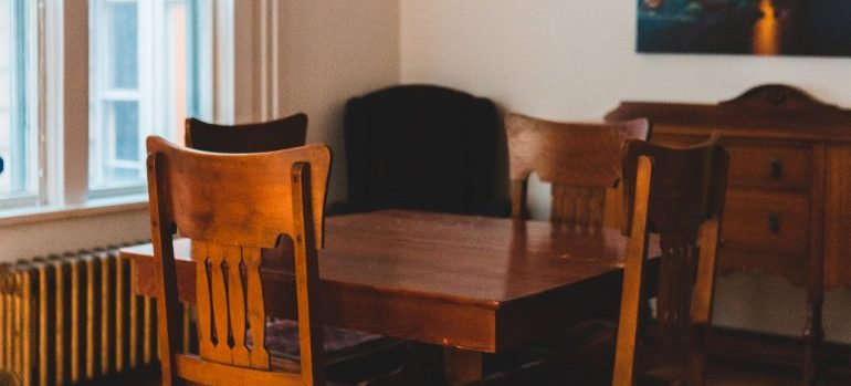 A table and chairs in the old dining room.