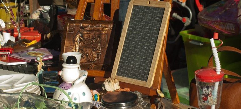 Various things on display for garage sale, when moving to Richmond TX.